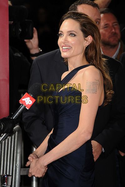 Angelina Jolie.'In The Land Of Blood And Honey' Los Angeles Premiere held at The Arclight Theatre, Hollywood, California, USA..8th December 2011.half length side dress microphone interview black navy blue one shoulder smiling.CAP/ADM/BP.©Byron Purvis/AdMedia/Capital Pictures.