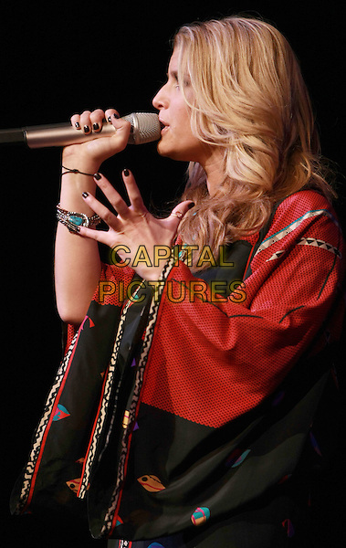 JESSICA SIMPSON.5th Annual Nina's Night Out to benefit The Rape Crisis Center featuring Jessica Simpson held at the Pearl inside the Palms Hotel Casino, Las Vegas, Nevada, USA, 18 September 2008..performing live on stage in concert gig country music half length black red print top tunic kaftan profile microphone .CAP/ADM/MJT.©MJT/Admedia/Capital Pictures