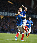 Lee Wallace (bottom) celebrates as he scores goal no 2 for Rangers after he turned in a short corner kick by team mate Ian Black (top)