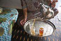 Morocco - Tidzi - Amina Hammoush, 40, prepares Berber tea at home.