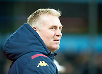 30th October 2019; Villa Park, Birmingham, Midlands, England; English Football League Cup, Carabao Cup, Aston Villa versus Wolverhampton Wanderers; Head Coach of Aston Villa Dean Smith watches his players on the field before the match  - Strictly Editorial Use Only. No use with unauthorized audio, video, data, fixture lists, club/league logos or 'live' services. Online in-match use limited to 120 images, no video emulation. No use in betting, games or single club/league/player publications