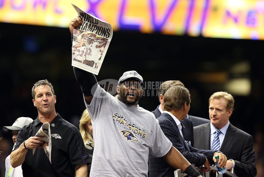 Feb 3, 2013; New Orleans, LA, USA; Baltimore Ravens inside linebacker Ray Lewis (middle) and head coach John Harbaugh (left) celebrate after defeating the San Francisco 49ers in Super Bowl XLVII at the Mercedes-Benz Superdome. Mandatory Credit: Mark J. Rebilas-