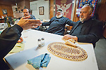 Father Blasko Paraklis Deacon Triva Pavlov and Farther Budimir Andjelic converse with St. Sava Church president Dan Stojanovich as he makes his point after dinner, St. Sava Church, Jackson