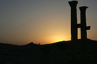 The Baalshamin sanctuary, Chief fertility god, begun in 2nd century BC, colonnaded courtyard added after 67 AD, cella in 130 AD, columns silhouetted against sunset, Palmyra, Syria Picture by Manuel Cohen