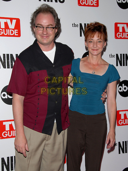 JOHN BILLINGSLEY & GUEST.The ABC, TV Guide and Warner Bros. Television Presentation of The Nine Screening held at L.A. Center Studios in Los Angeles, California, USA..September 18th, 2006.Ref: DVS.half length black burgundy teal blue red.www.capitalpictures.com.sales@capitalpictures.com.©Debbie VanStory/Capital Pictures