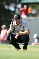 Bethesda, MD - June 29, 2014: Brendan Steele analyzes the break of the 14th hole putting green during the Final Round of the Quicken Loans National at the Congressional Country Club in Bethesda, MD., June 29, 2014. (Photo by Elliott Brown/Media Images International)
