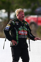 Mar 15, 2014; Gainesville, FL, USA; NHRA top fuel dragster driver Terry McMillen reacts as he walks away from his car after exploding an engine and blowing a tire during qualifying for the Gatornationals at Gainesville Raceway Mandatory Credit: Mark J. Rebilas-USA TODAY Sports