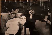 Old Photograph of Sue Rockford with her son, alongside (right) is Mica Nava with her son, at the women's Liberation Conference in Ruskin College, Oxfird. 1970. Sue Crockford photographed at her home in North London . Sue Crockford was a member of the first Tufnell Park Women's Liberation group, set up in 1968. She was also co-organiser of a radical film collective, Angry Arts, which made a unique record of the 1970 Women's Liberation Conference in the film A Woman's Place. The first four WLM demands that you can read about in the introduction to this section emerged out of the 1970 conference, and were passed the following year in Skegness.