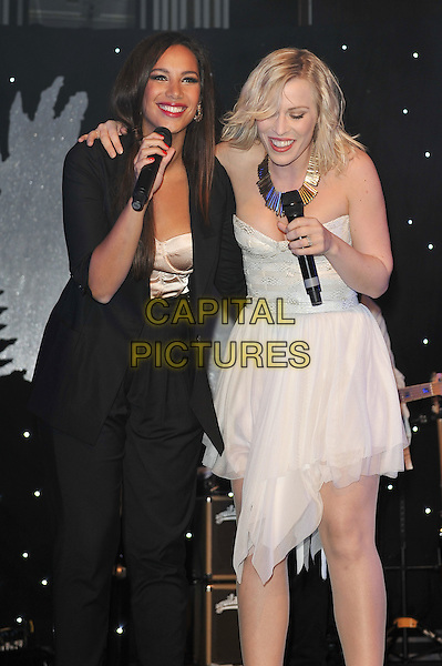 Natasha Bedingfield and Leona Lewis.'Global Angels Awards', The Park Plaza Hotel, Westminster, London, England. 2nd December 2011..music on stage live concert gig performing half length microphone singing strapless white dress black jacket hand arm duet around 3/4 .CAP/MAR.© Martin Harris/Capital Pictures.