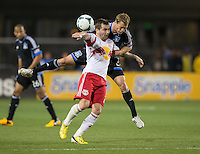 March 10th, 2013: Ty Harden tries head the ball over Jonny Miller during a game at Buck Shaw Stadium, Santa Clara, Ca.   Earthquakes defeated Red Bulls 2-1
