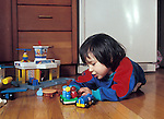 Berkeley CA 2-yr-old girl in fantasy play with boy-type car toys  MR