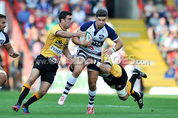 Ben Mosses takes on the Cornish Pirates defence. Greene King IPA Championship match, between Bristol Rugby and Cornish Pirates on September 21, 2014 at Ashton Gate in Bristol, England. Photo by: Patrick Khachfe / JMP