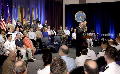 United States Secretary of Defense Donald H. Rumsfeld responds to a question from the audience during a town hall meeting in the Pentagon on May 11, 2004.  Rumsfeld and Vice Chairman of the Joint Chiefs of Staff General Peter Pace made opening remarks and then took questions from the audience of military and Department of Defense (DoD) civilians. <br /> Mandatory Credit: Robert D. Ward / DoD via CNP
