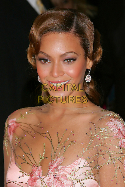 BEYONCE KNOWLES.at the NY premiere of Pink Panther at the Ziegfeld Theatre, New York, NY, USA,.06 February 2006..portrait headshot sheer pink dress flowers  earrings silver drop dangly diamond smiling.Ref: ADM/JL.www.capitalpictures.com.sales@capitalpictures.com.©Capital Pictures.