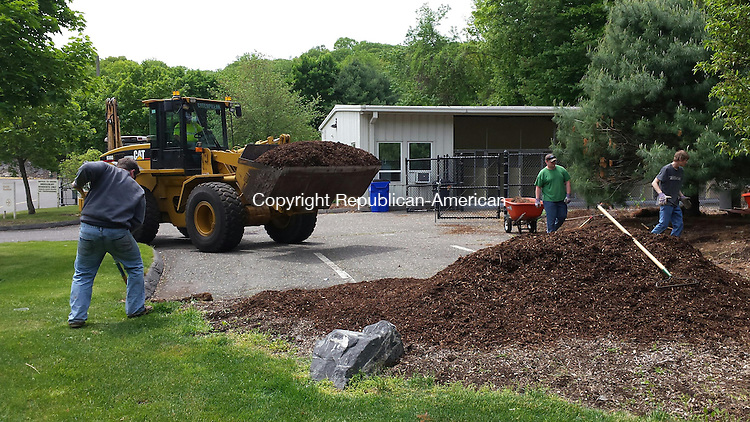 MIDDLEBURY, CT: 20 May 2015:052015BB01: MIDDLEBURY --- A Public Works crew spruces up the grounds of the town dog shelter Wednesday. Shoveling mulch, from left, are Steve Harrison, Sal Longo and Pat Cragan. Operating the payloader is Clyde O'Bar, a transfer station operator. Bill Bittar Republican-American