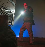 Officer Hawkins (Will Patton) investigates an abandoned bus<br /> Halloween (2018)<br /> *Filmstill - Editorial Use Only*<br /> CAP/RFS<br /> Image supplied by Capital Pictures