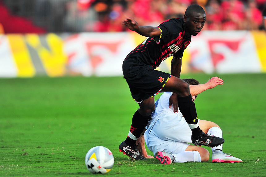 Chris Odoi-Atsem of the Terrapins goes after the ball after colliding with an opponent. Maryland defeated Penn State in over time 3-2 during an NCAA D-1 soccer match at Ludwig Field in College Park, MD on Sunday, September 18, 2016.  Alan P. Santos/DC Sports Box