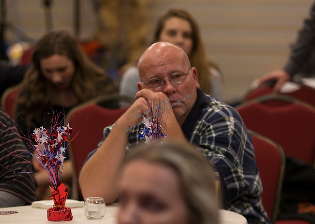 Adam Laxalt supporters watch election results at the Grand Sierra Resort in Reno, Nev., Tuesday, Nov. 6, 2018. (AP Photo/Tom R. Smedes)