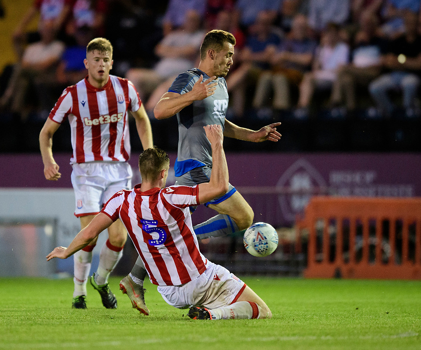 Lincoln City's Harry Toffolo vies for possession with Stoke City's Liam Lindsay<br /> <br /> Photographer Chris Vaughan/CameraSport<br /> <br /> Football Pre-Season Friendly - Lincoln City v Stoke City - Wednesday July 24th 2019 - Sincil Bank - Lincoln<br /> <br /> World Copyright © 2019 CameraSport. All rights reserved. 43 Linden Ave. Countesthorpe. Leicester. England. LE8 5PG - Tel: +44 (0) 116 277 4147 - admin@camerasport.com - www.camerasport.com