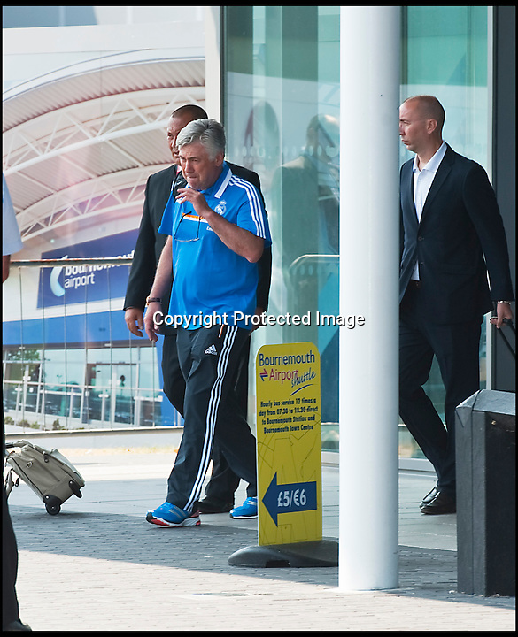 BNPS.co.uk (01202 558833)<br /> Pic: PhilYeomans/BNPS<br /> <br /> Ancelotti emerges from the terminal building.<br /> <br /> Footballing aristocrats Real Madrid flew into the unlikely enviroment of Bournemouth today for a much anticipated friendly against the seaside town's football team.<br /> <br /> Despite fears that their second team would turn up excited fans at the airport couldn't beleive their eyes when Ancelotti led out Ronaldo, Zidane, Kaka, Modric and many more stars from the terminal building.