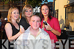 Christy Walsh takes the hot seat as hair dresser Meiram O'Connor, of Exelance hair Salon Listowel gets ready to chop of his curles in aid of Our Lady's Hospital for sick children in Crumlin Dublin on Saturday night. Looking on is his girlfriend Sheila Enright and Daisy Walsh..