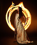 4/7/04 --Al Diaz/Miami Herald Staff--Miami--Performing artist Amber Joy Rava forms a perfect union between fire and dance as she is drapped in the Constitution of the United States.