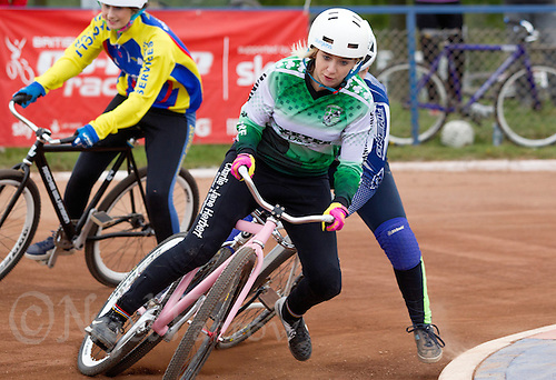 13 SEP 2014 - IPSWICH, GBR - Charlie-Jane Herbert from Exeter Aces leads the way round a bend during a heat of the 2014 British Women's Club Cycle Speedway Championships at Whitton Sports & Community Centre in Ipswich, Great Britain (PHOTO COPYRIGHT © 2014 NIGEL FARROW, ALL RIGHTS RESERVED)