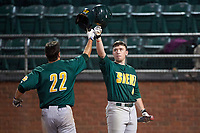 Siena Saints center fielder Dan Swain (22) celebrates with Jordan Bishop (4) after hitting a home run during a game against the Stetson Hatters on February 23, 2016 at Melching Field at Conrad Park in DeLand, Florida.  Stetson defeated Siena 5-3.  (Mike Janes/Four Seam Images)