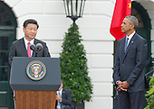 President XI Jinping of China makes remarks as United States President Barack Obama looks on during an official State Arrival ceremony on the South Lawn of the White House in Washington, DC on Friday, September 25, 2015.<br /> Credit: Ron Sachs / CNP