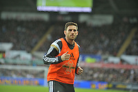 SWANSEA, WALES - JANUARY 17:   of  during the Barclays Premier League match between Swansea City and Chelsea at Liberty Stadium on January 17, 2015 in Swansea, Wales. Swansea's Angel Rangel warming up