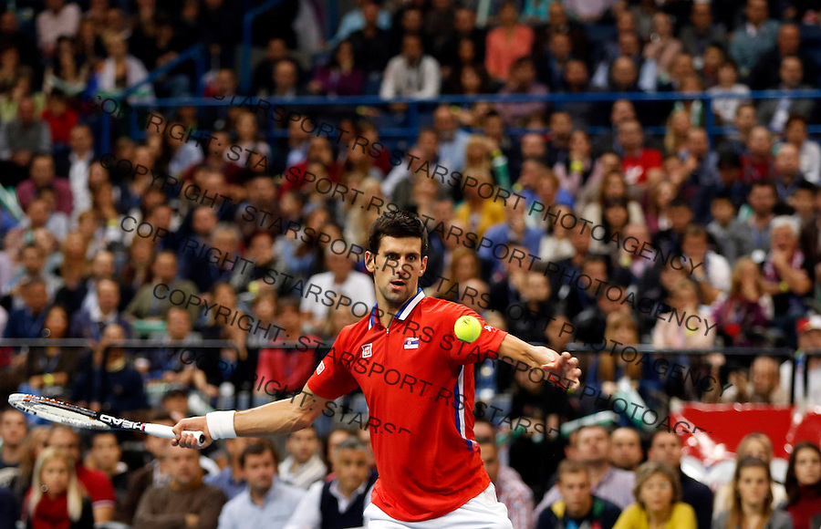 BELGRADE, SERBIA - NOVEMBER 17: Novak Djokovic of Serbia  play a forehand during the mens singles match between Novak Djokovic of Serbia and Tomas Berdych of Czech Republic on day three of the Davis Cup World Group Final between Serbia and Czech Republic at Kombank Arena on November 17, 2013 in Belgrade, Serbia. (Photo by Srdjan Stevanovic/Getty Images)