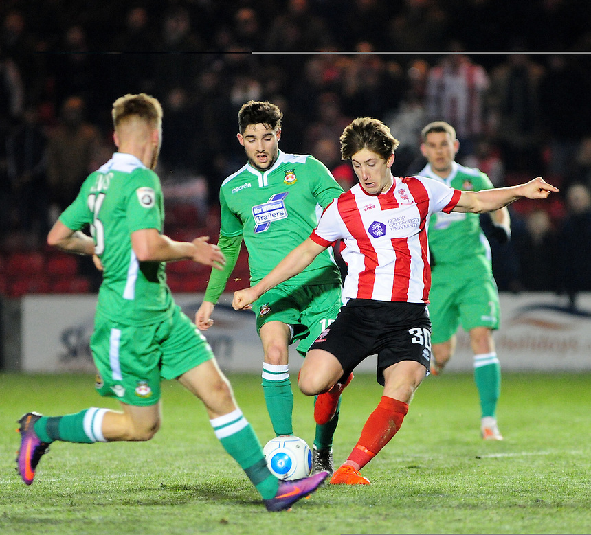Lincoln City's Alex Woodyard vies for possession with Wrexham's Jordan Evans and Rob Evans<br /> <br /> Photographer Andrew Vaughan/CameraSport<br /> <br /> Vanarama National League - Lincoln City v Wrexham - Tuesday 29th November 2016 - Sincil Bank - Lincoln<br /> <br /> World Copyright &copy; 2016 CameraSport. All rights reserved. 43 Linden Ave. Countesthorpe. Leicester. England. LE8 5PG - Tel: +44 (0) 116 277 4147 - admin@camerasport.com - www.camerasport.com