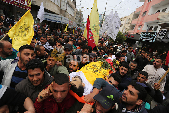 Mourners carry the body of Palestinian Mosa Mosa, 23, who was died of his wounds which he sustained by Israeli forces during clashes in tents protest where Palestinians demand the right to return to their homeland at the Israel-Gaza border, during his funeral in Dair Al Balah in the central of Gaza Strip on March 12, 2019. Photo by Ashraf Amra