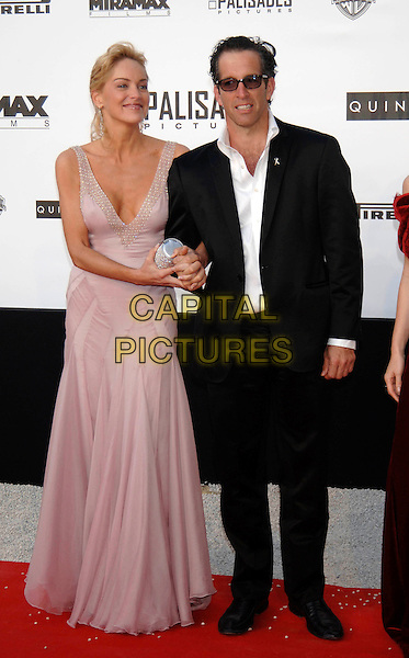 SHARON STONE & KENNETH COLE.58th Cannes International Film Festival: Cinema Against AIDS 2005 in aid of amfAR.May 19th, 2005.full length purple lilac plunfing neckline dress arms linked sunglasses shades black suit.www.capitalpictures.com.sales@capitalpictures.com.©Capital Pictures