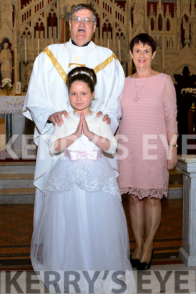 Leila Bukajova who received her First Holy Communion in St. Jamesí Church, Killorglin on Saturday, pictured with from Fr. Michael Fleming  and School Principal Dolores Johnston.