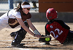 Colorado Northwestern's Lola Williams slides safely pass the tag of Western Nevada's Alia Cox in a college softball game in Carson City, Nev., on Friday, Feb. 22, 2013..Photo by Cathleen Allison/Nevada Photo Source