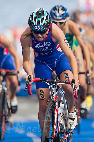 24 AUG 2013 - STOCKHOLM, SWE - Vicky Holland (GBR) of Great Britain climbs the hill through transition  during the bike at the women's ITU 2013 World Triathlon Series round in Gamla Stan, Stockholm, Sweden (PHOTO COPYRIGHT © 2013 NIGEL FARROW, ALL RIGHTS RESERVED)
