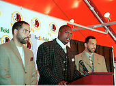 Washington Redskins linebacker LaVar Arrington (56), center, the Redskins first pick in the first round of the 2000 NFL Draft (second pick overall) out of Penn State University, speaks to the media at Redskin Park in Ashburn, Virginia after agreeing to a 6 year contract with a $10.75 million signing bonus on July 22, 2000.  His agents Kevin Poston, left, and Carl Poston, right, appear with him.  La Var will begin practicing with his teammates tomorrow.  With the last holdout reporting, the Redskins have all of their players under contract. <br /> Credit: Arnie Sachs / CNP