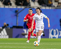 GRENOBLE, FRANCE - JUNE 15: Olivia Chance #22 of the New Zealand National Team brings the ball forward as Jessie Fleming #17 of the Canadian National Team pressures during a game between New Zealand and Canada at Stade des Alpes on June 15, 2019 in Grenoble, France.