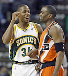 .Seattle SuperSonics Ray Allen jokes (34) with Los Angeles Clippers Cuttion Mobley before tipoff  on Friday, April 14, 2006 at the Key Arena in Seattle.  Jim Bryant Photo. ©2010. All Rights Reserved.
