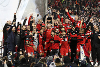 Toronto, Ontario - Saturday December 09, 2017: Michael Bradley lifts the Philip F. Anschutz Trophy overhead while celebrating with his teammates. Toronto FC defeated the Seattle Sounders FC 2-0 in MLS Cup 2017, Major League Soccer's (MLS) championship game played at BMO Field.