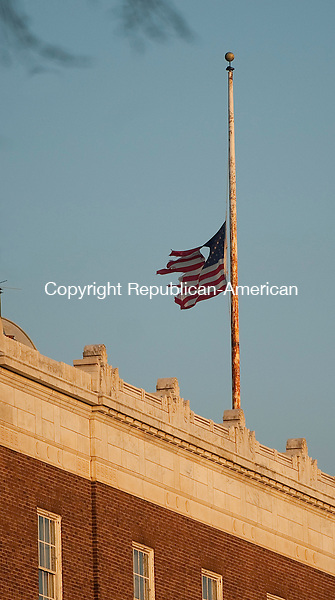WATERBURY, CT 120313JS03- A tattered American flag files atop the Southern New England Telephone Company  on Grand Street in Waterbury on Tuesday. <br /> Jim Shannon Republican-American