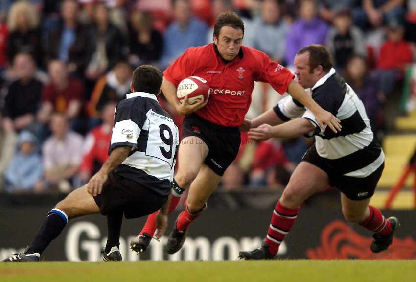 Photo: Richard Lane..Barbarians v Wales at Ashton Gate, Bristol. 26/05/2004..Rhys Williams attacks.