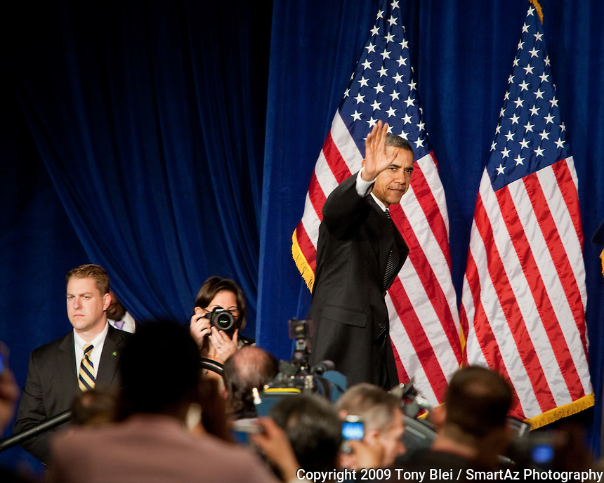 President Barack Obama waves to the crowd at Dobson High School in Mesa, Arizona, February 18, 2009 as moments before announcing a plan to help Americans overcome the current financial crisis.