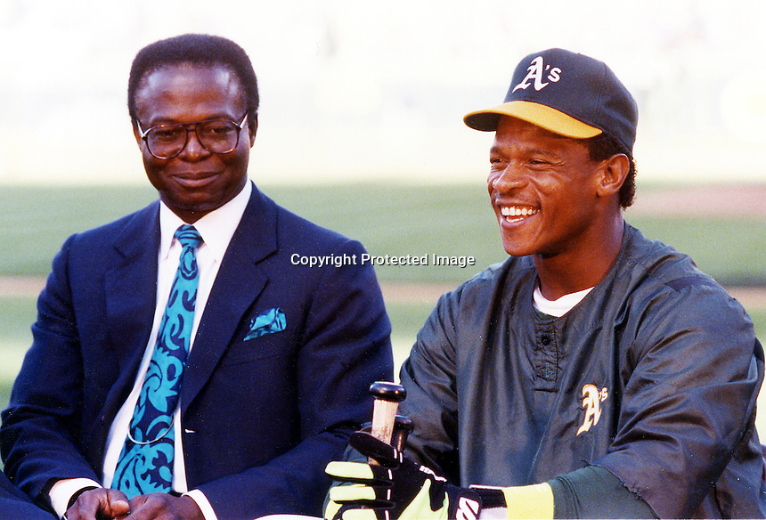 Lou Brock and Rickey Henderson after Rickey stole the base that beat Brock's stolden base record..(1981 photo by Ron Riesterer)