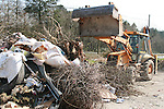 Rubbish being cleared away on the Collon to Slane road...Photo NEWSFILE/Jenny Matthews.(Photo credit should read Jenny Matthews/NEWSFILE)....This Picture has been sent you under the condtions enclosed by:.Newsfile Ltd..The Studio,.Millmount Abbey,.Drogheda,.Co Meath..Ireland..Tel: +353(0)41-9871240.Fax: +353(0)41-9871260.GSM: +353(0)86-2500958.email: pictures@newsfile.ie.www.newsfile.ie.FTP: 193.120.102.198.