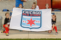 Chicago, IL - Saturday Sept. 24, 2016: Chicago Red Stars flag bearers prior to a regular season National Women's Soccer League (NWSL) match between the Chicago Red Stars and the Washington Spirit at Toyota Park.