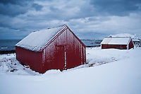 Red boat sheds in snow, Eggum, Lofoten islands, Norway