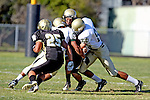 Palos Verdes, CA 10/30/09 - Logan Okuda (#25), Michael Daniels (MC# 88) in action during the Mira Costa Mustang vs Peninsula Panthers football game played at Peninsula High School.