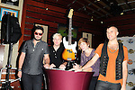 HOLLYWOOD, FL - OCTOBER 11: Branden Campbell, Chris Allen, Elaine Bradley and Tyler Glenn of Alternative rock band Neon Trees donate sign bass guitar memorabilia  to Hard Rock Hotel at Hard Rock Cafe! in the Seminole Hard Rock Hotel & Casino on October 11, 2011 in Hollywood, Florida. (Photo by Johnny Louis/jlnphotography.com)